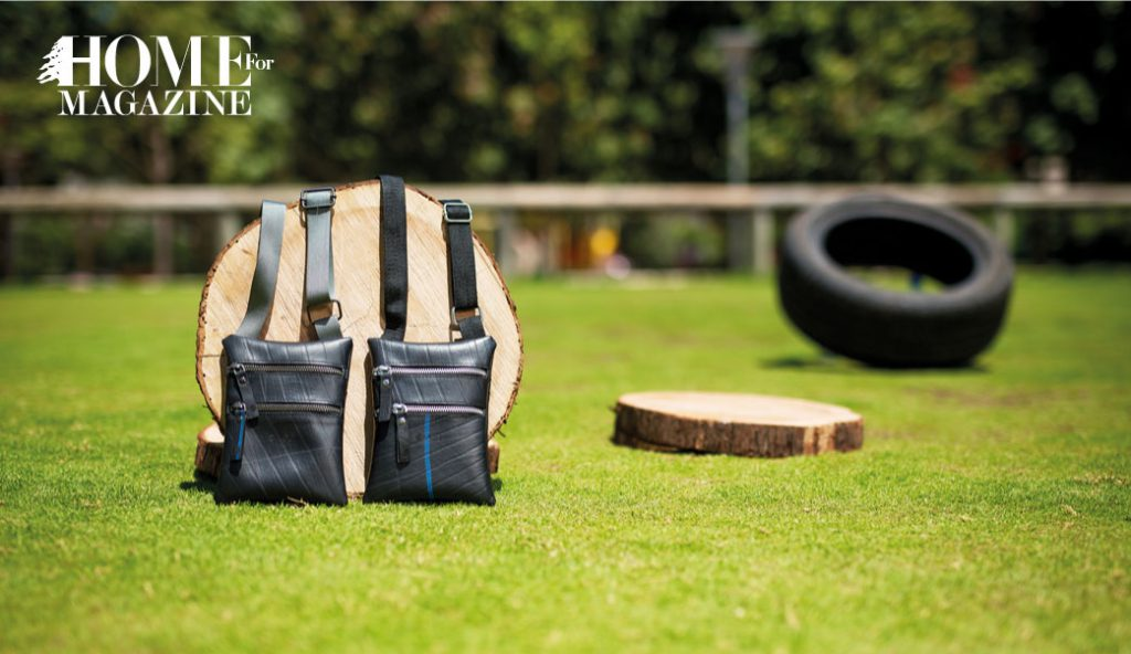 2 bags in black with a 2 woods and a black wheel on grass