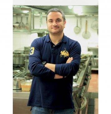 Man wearing navy in kitchen