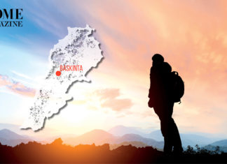 Hiker with sunset landscape and Lebanon's map with Baskinta's title