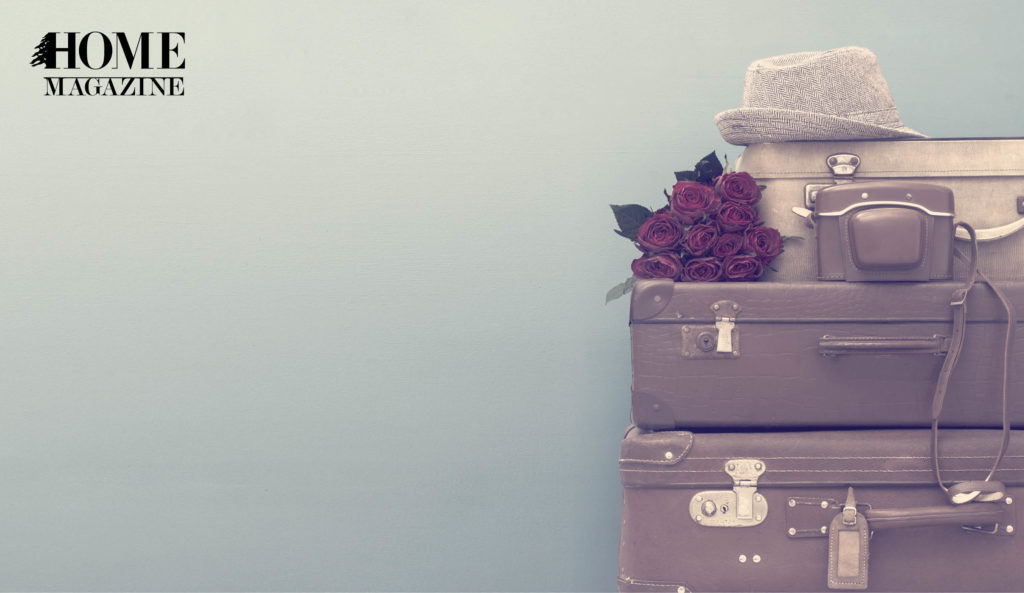 Luggage bags with a hat and red flowers