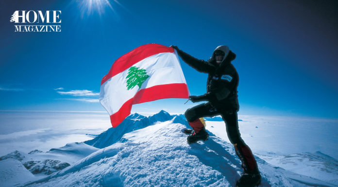 Man with Lebanese flag on snow slope