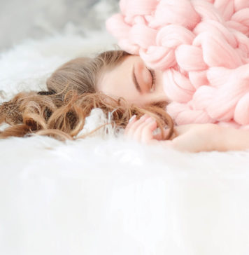 Girl sleeping with pink covers