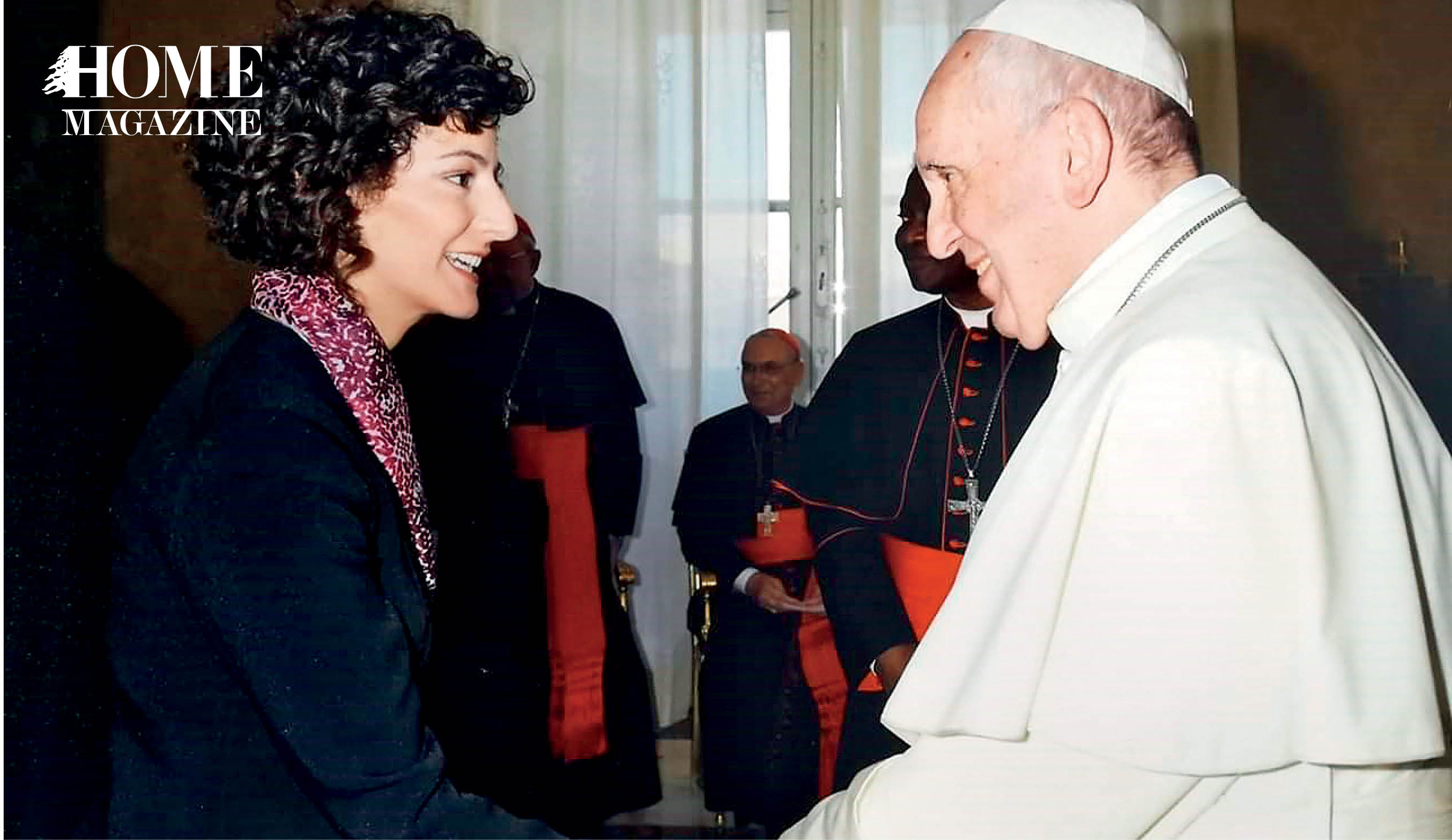 Woman shaking hand of Pope