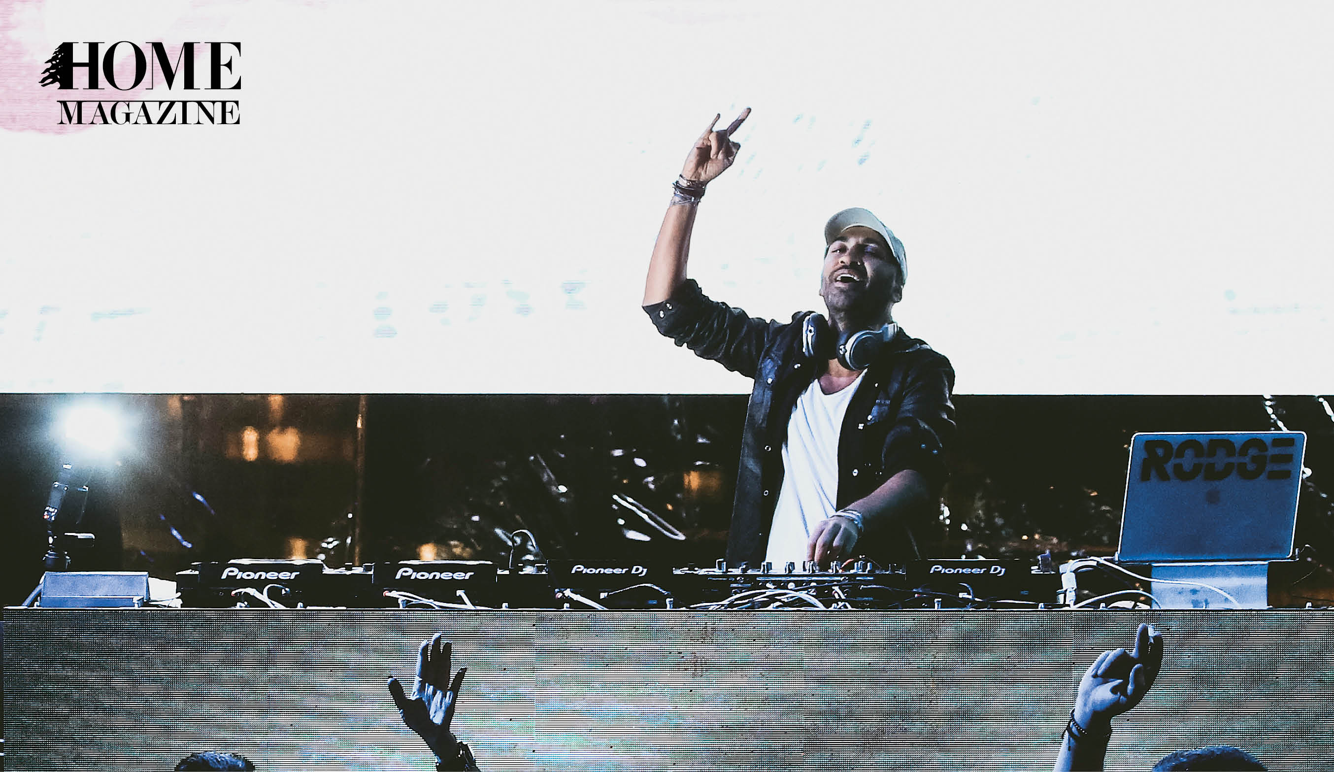 Male DJ with hand in air
