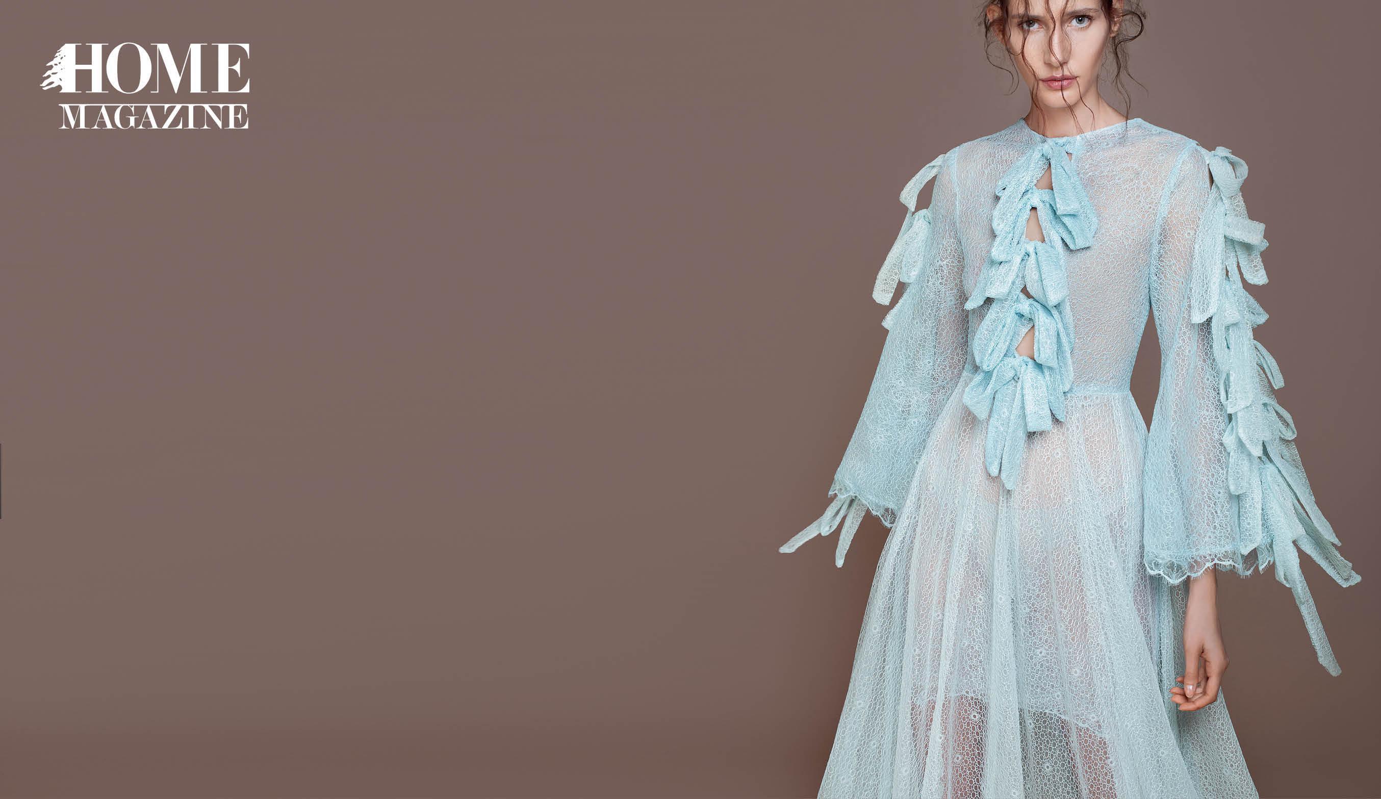Model in light blue dress