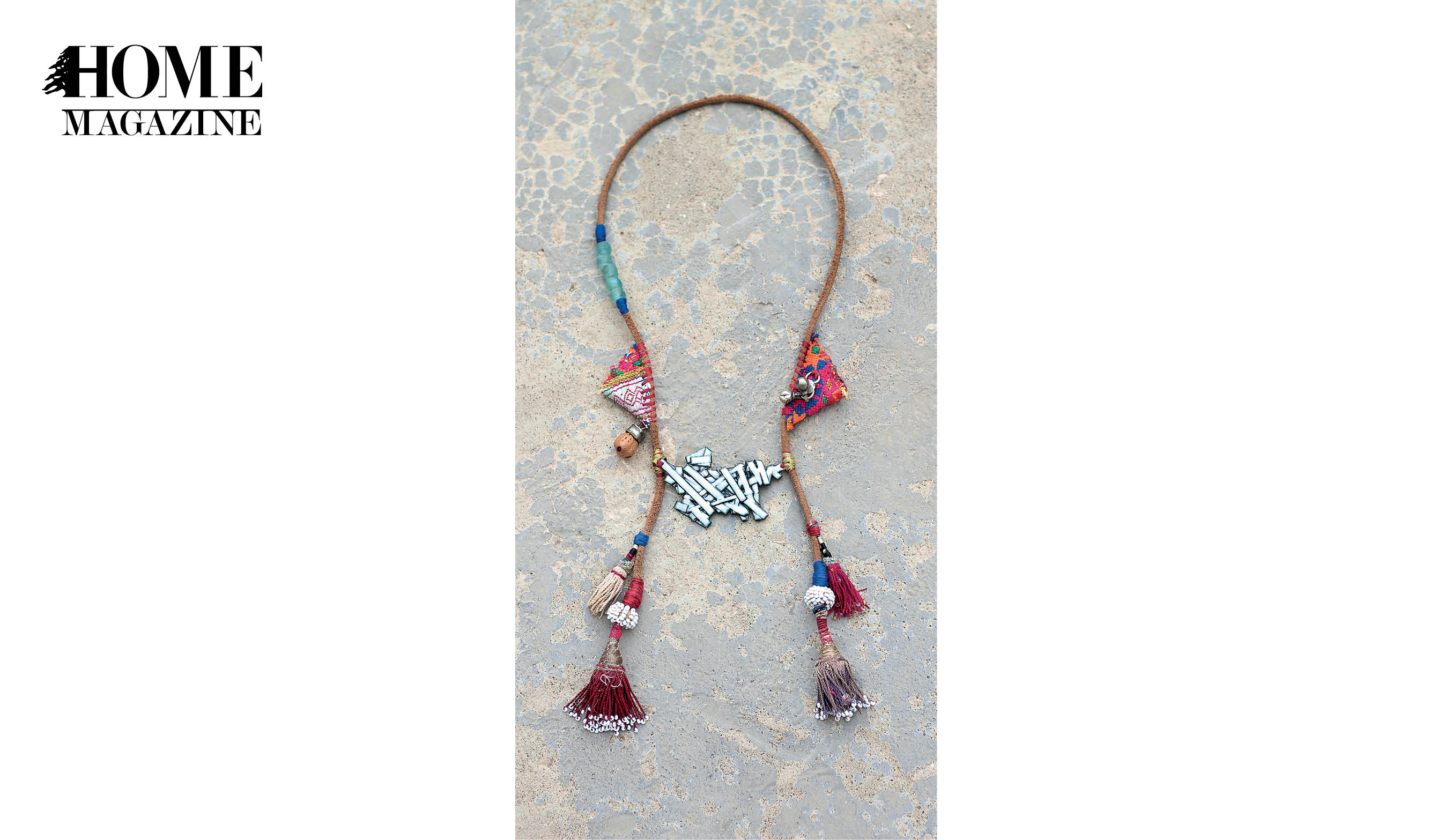 Necklace with middle white shape and multicolored textile