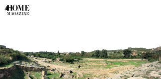 Green landscape with ruins