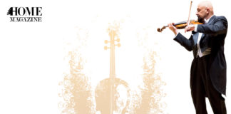 Man wearing black suit playing the violin on yellow-brown violin drawing backgroud
