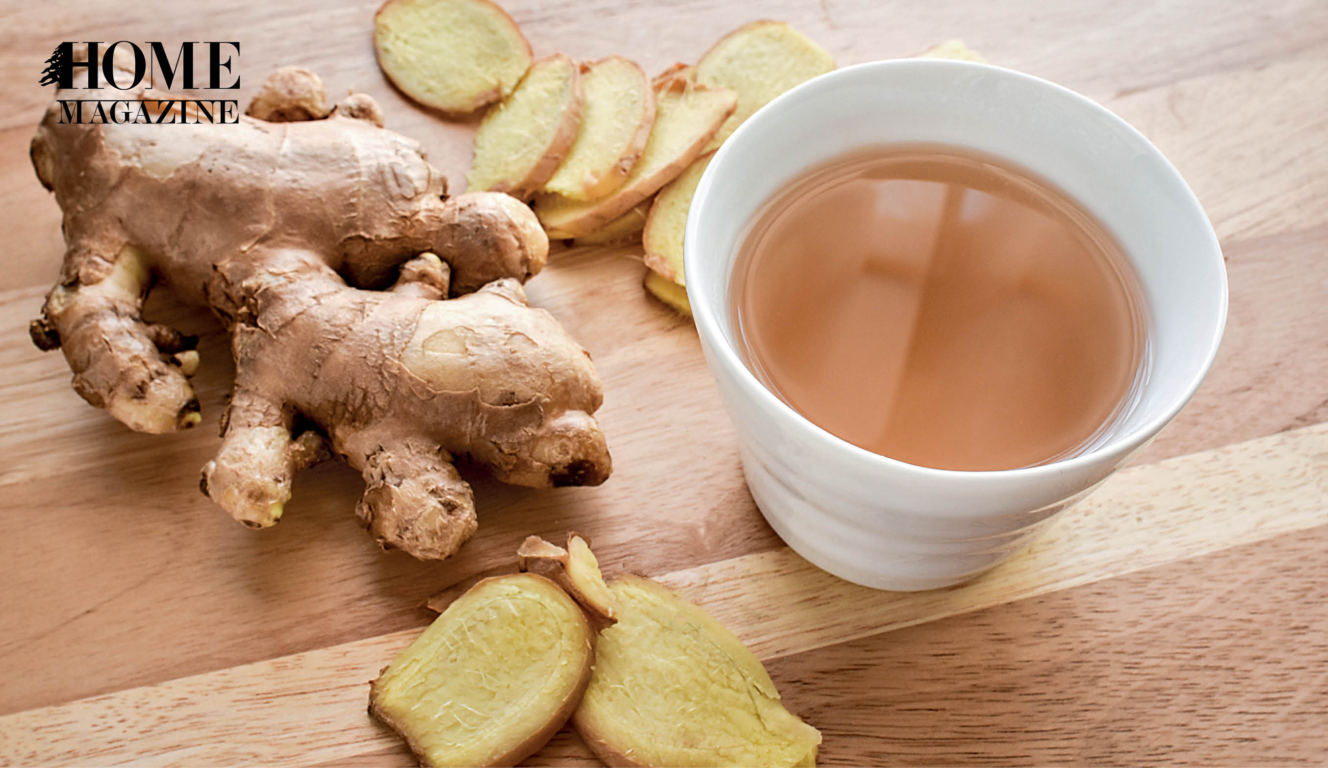 Ginger and ginger tea in white cup