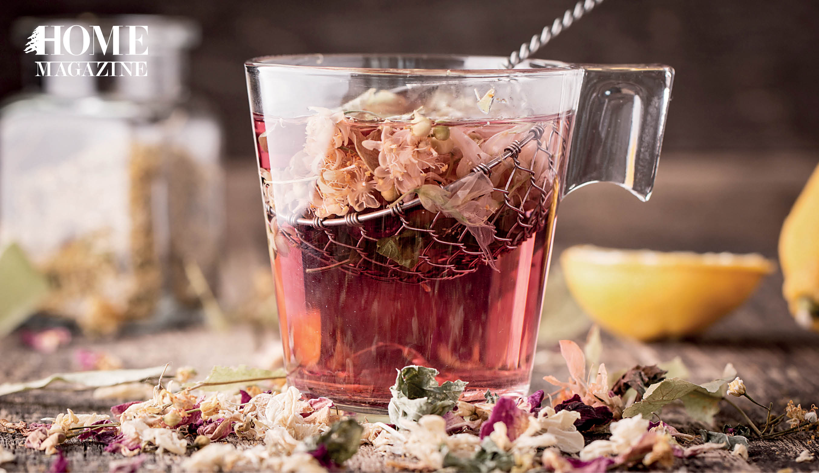Flower herbs and brown liquid in a cup