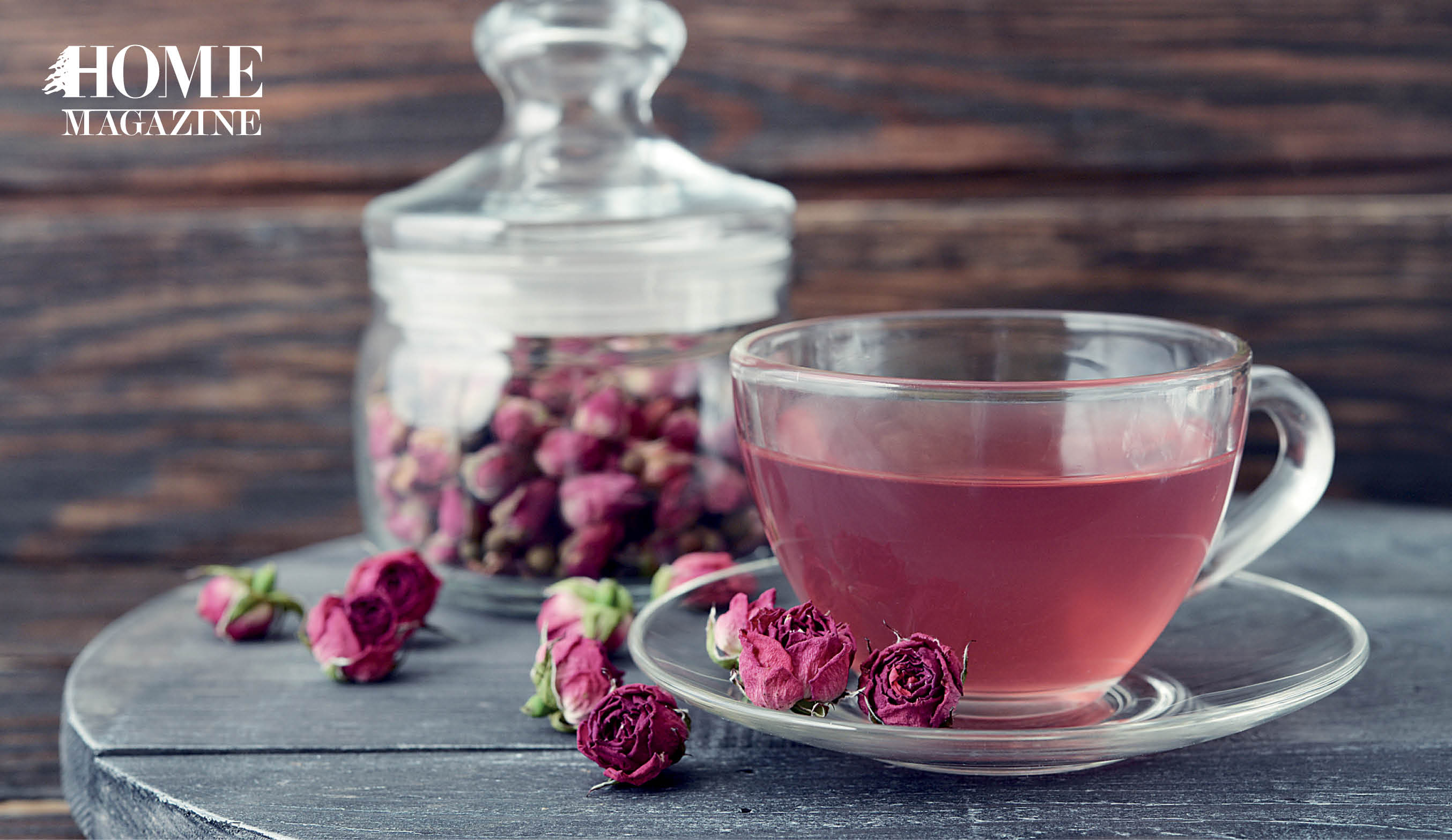 Pink roses with pink fluid in a cup