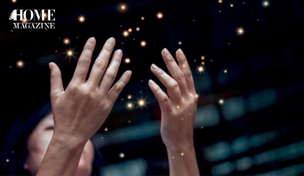 Hands raised praising