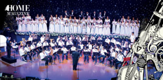 Choir and orchestra wearing white clothes on stage