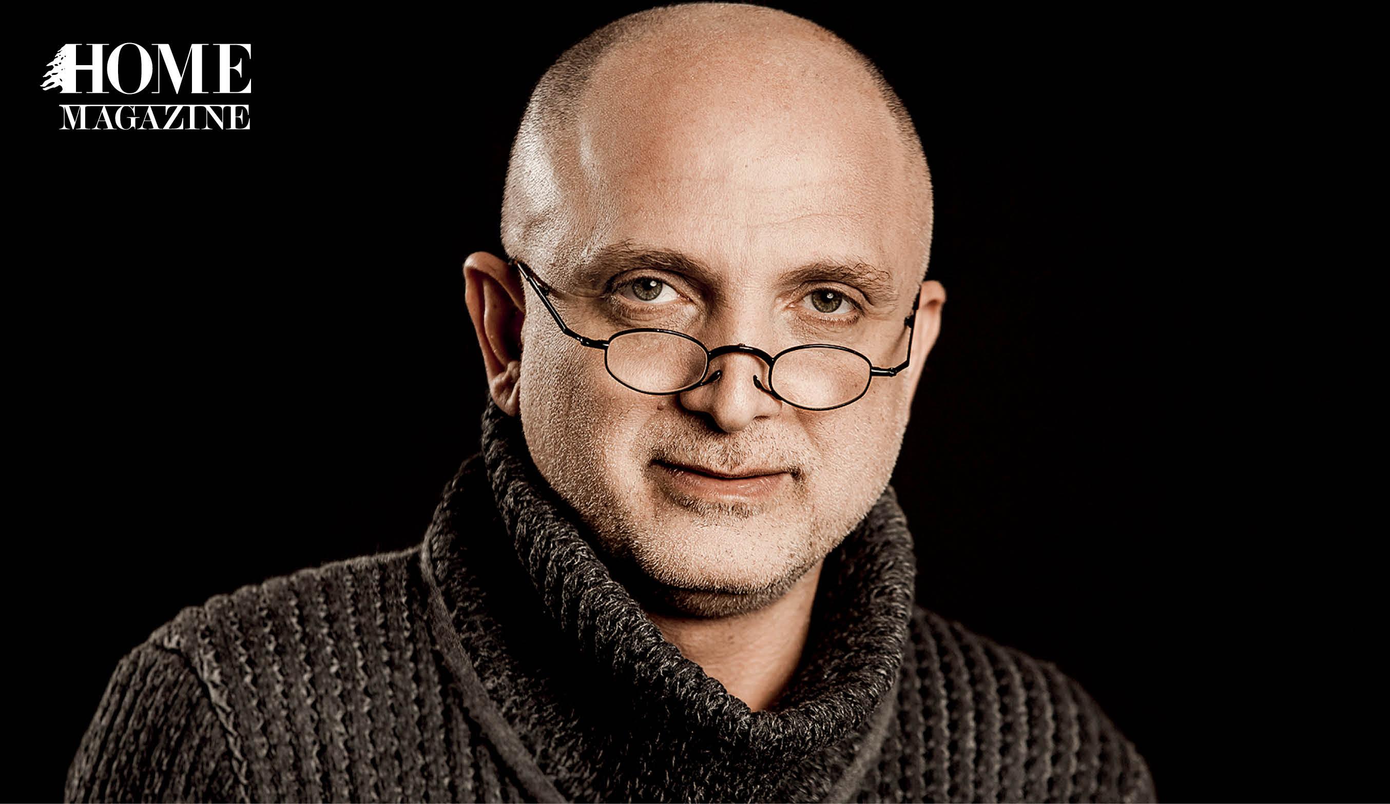Bald man wearing eyeglasses