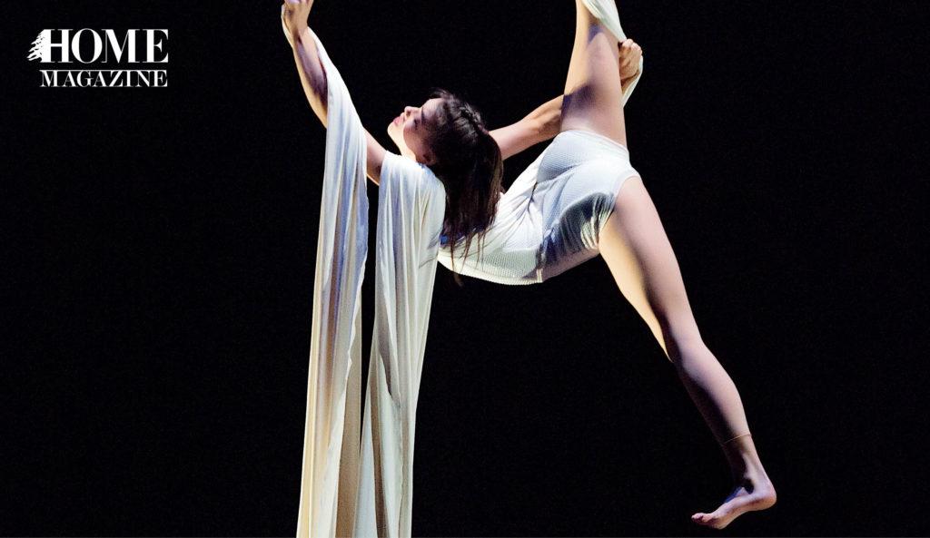 Girl swinging on white rope