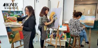 Three women painting