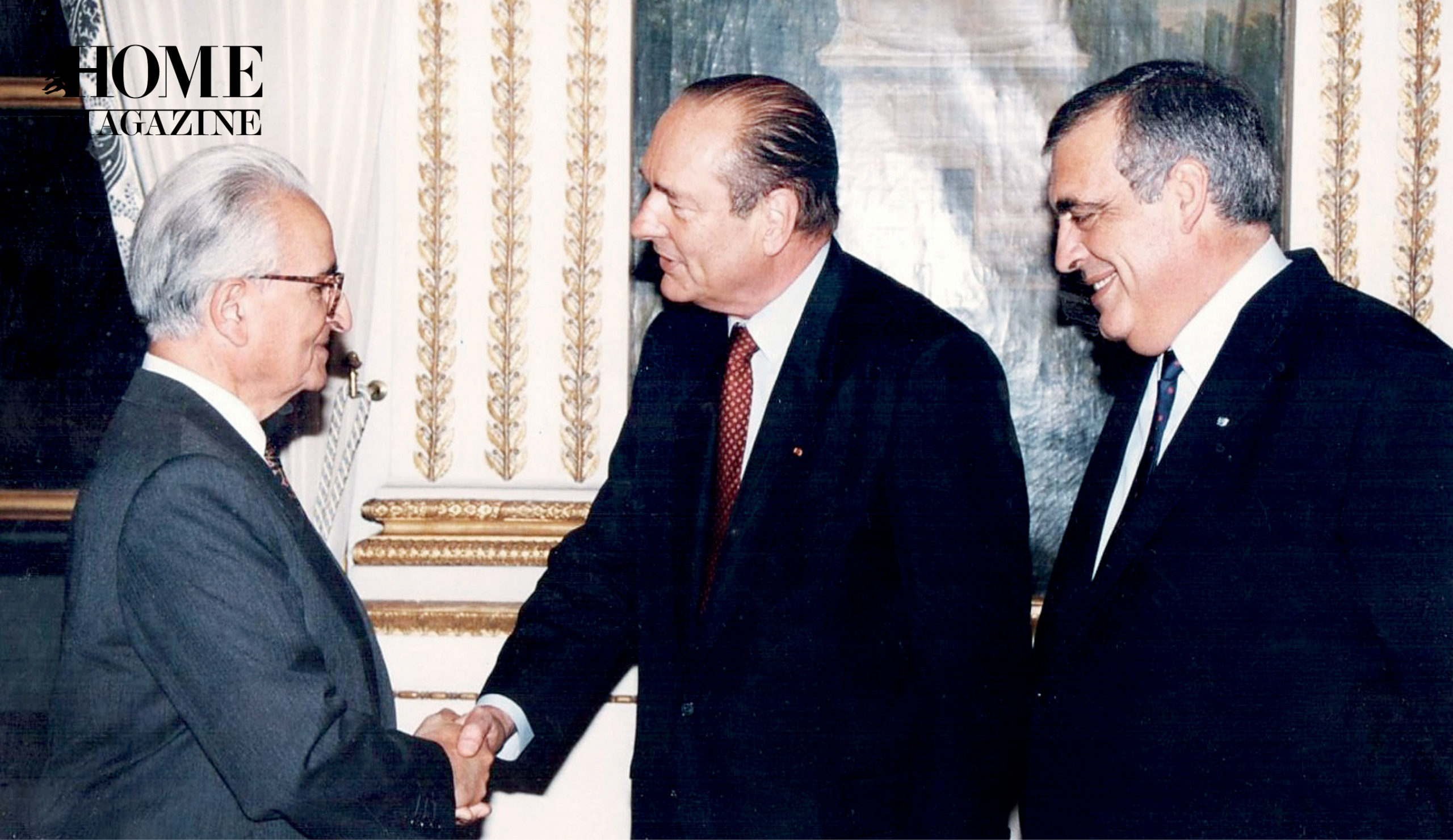Three men in suits shaking hands