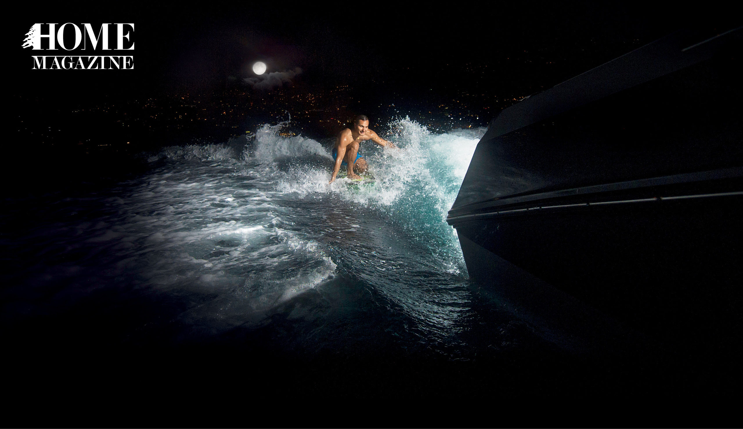 Man water surfing at night