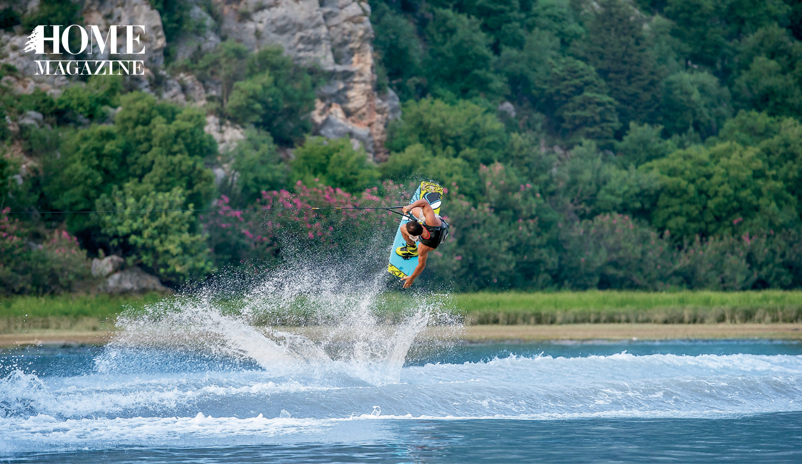 Man water surfing and flipping in the air