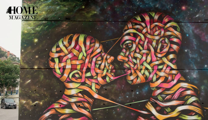 Multicolor painting of two human heads