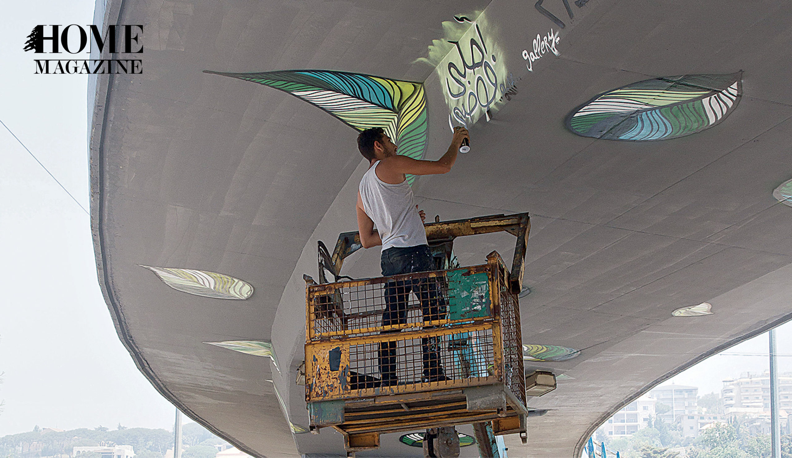 Man painting on bridge