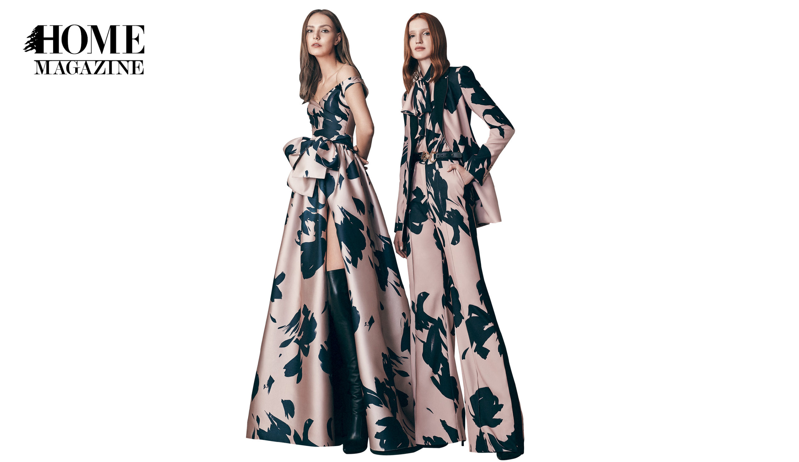Two models wearing flower printed black and bronze dresses