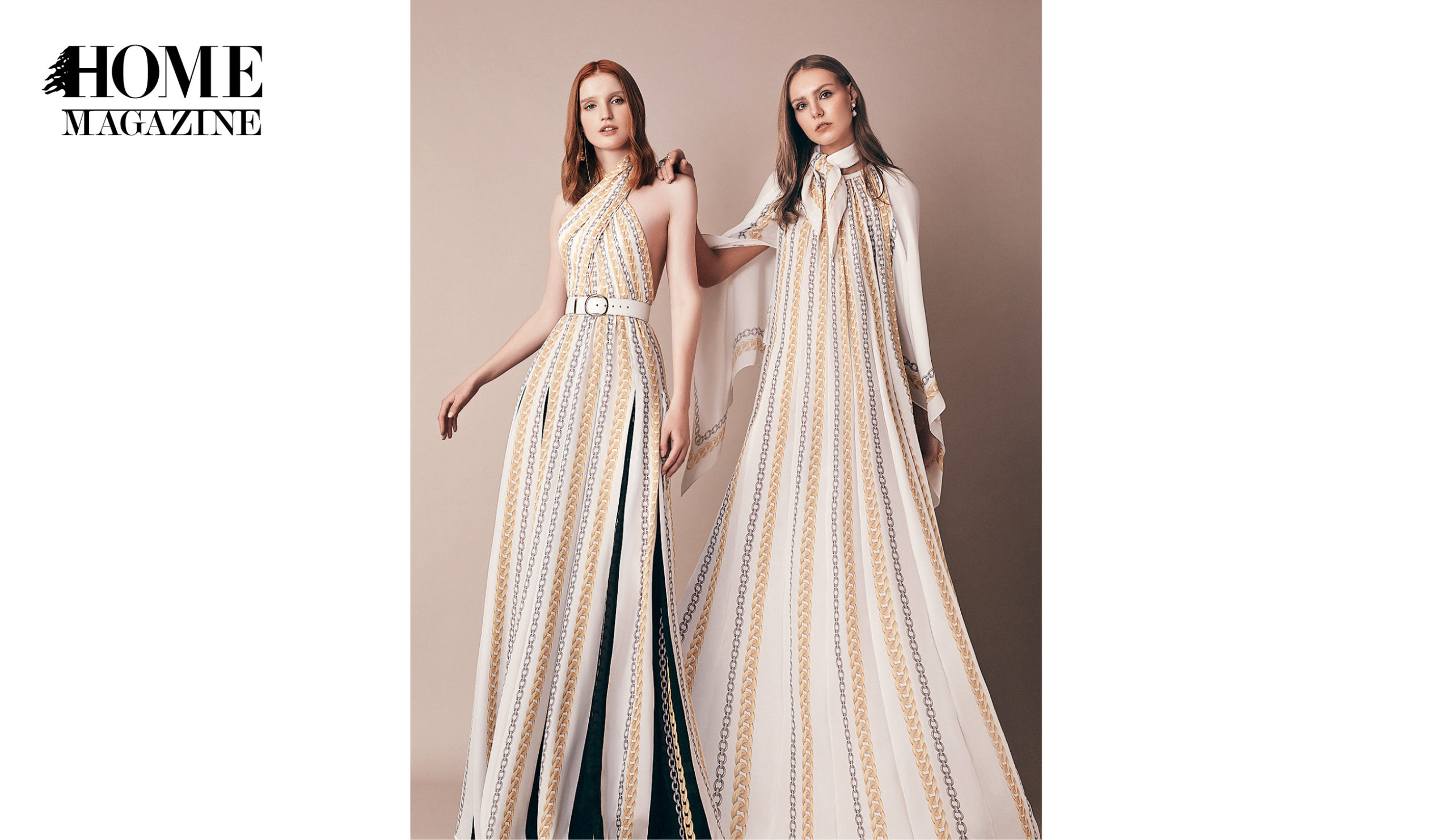 Two models wearing white striped dresses