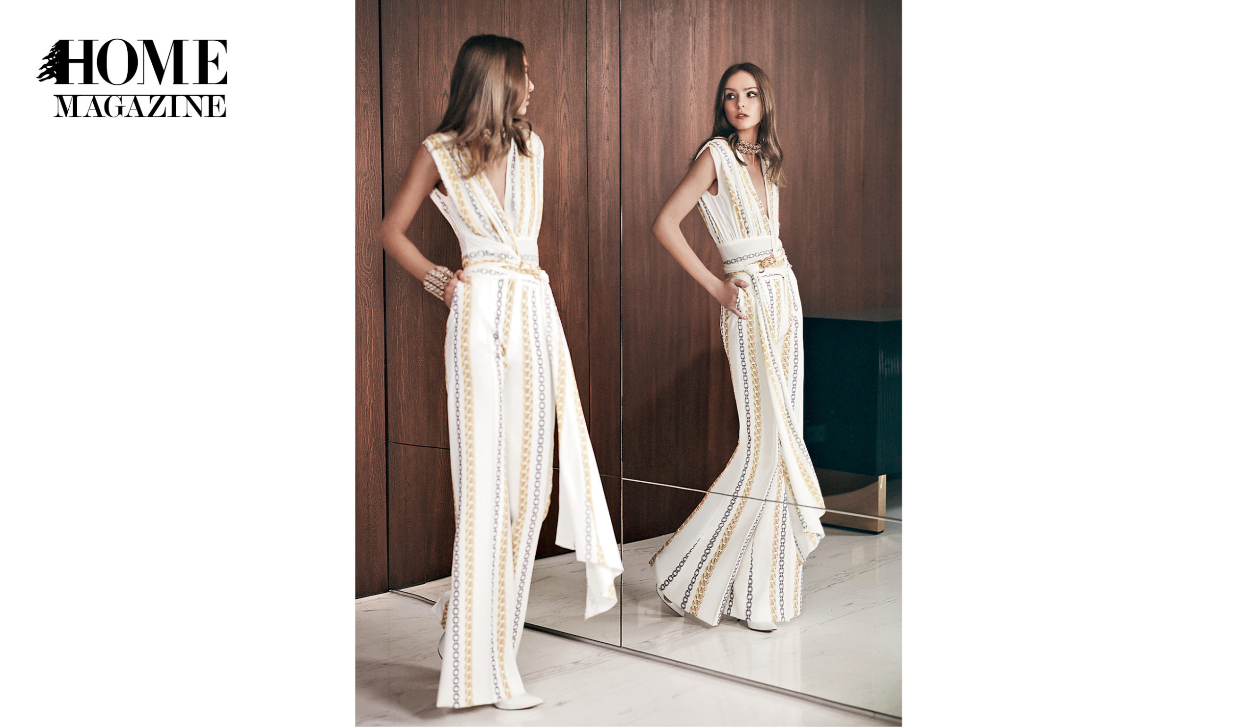 Model wearing white jumpsuit mirrored