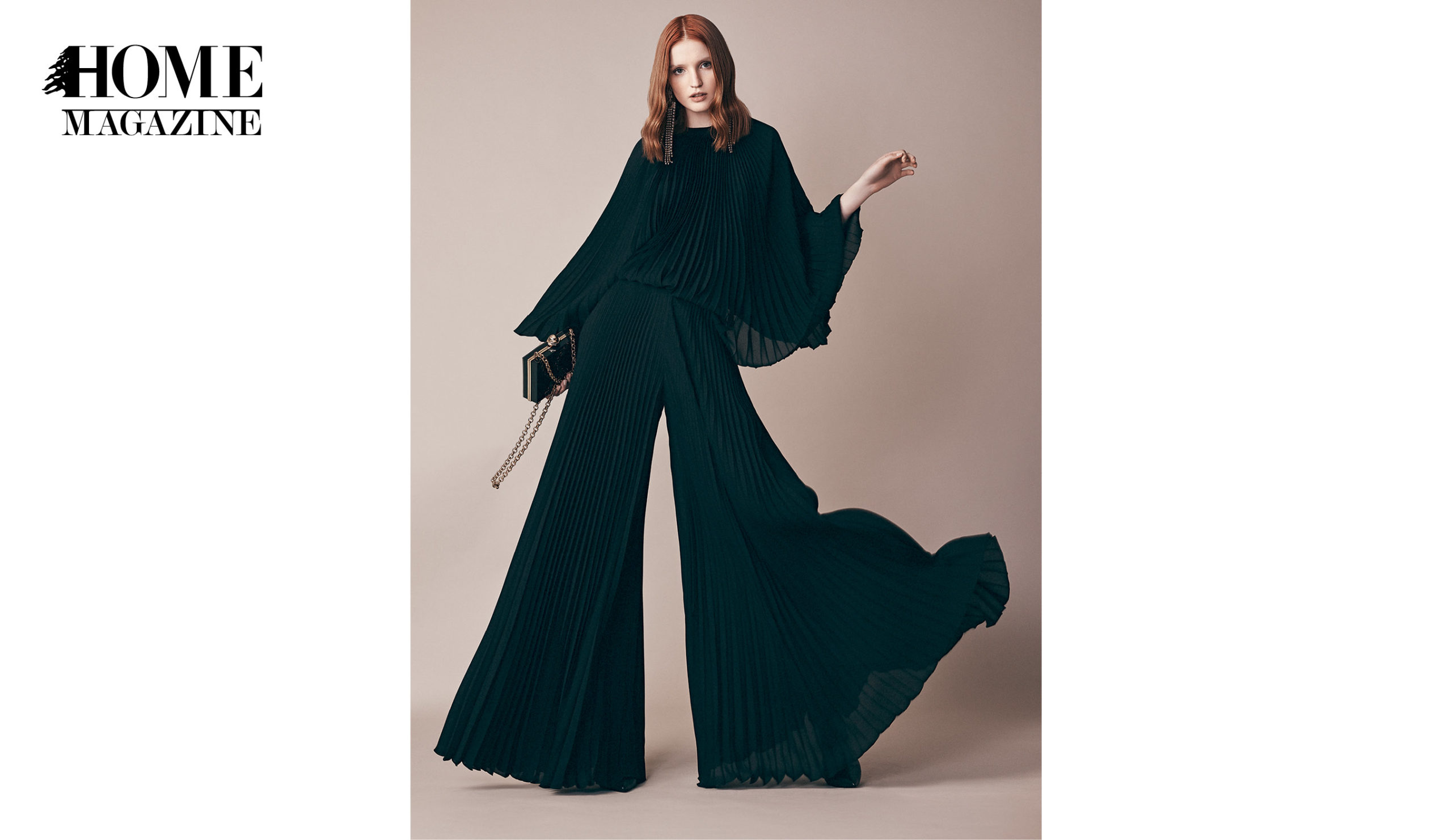 Model wearing black attire with flared trousers