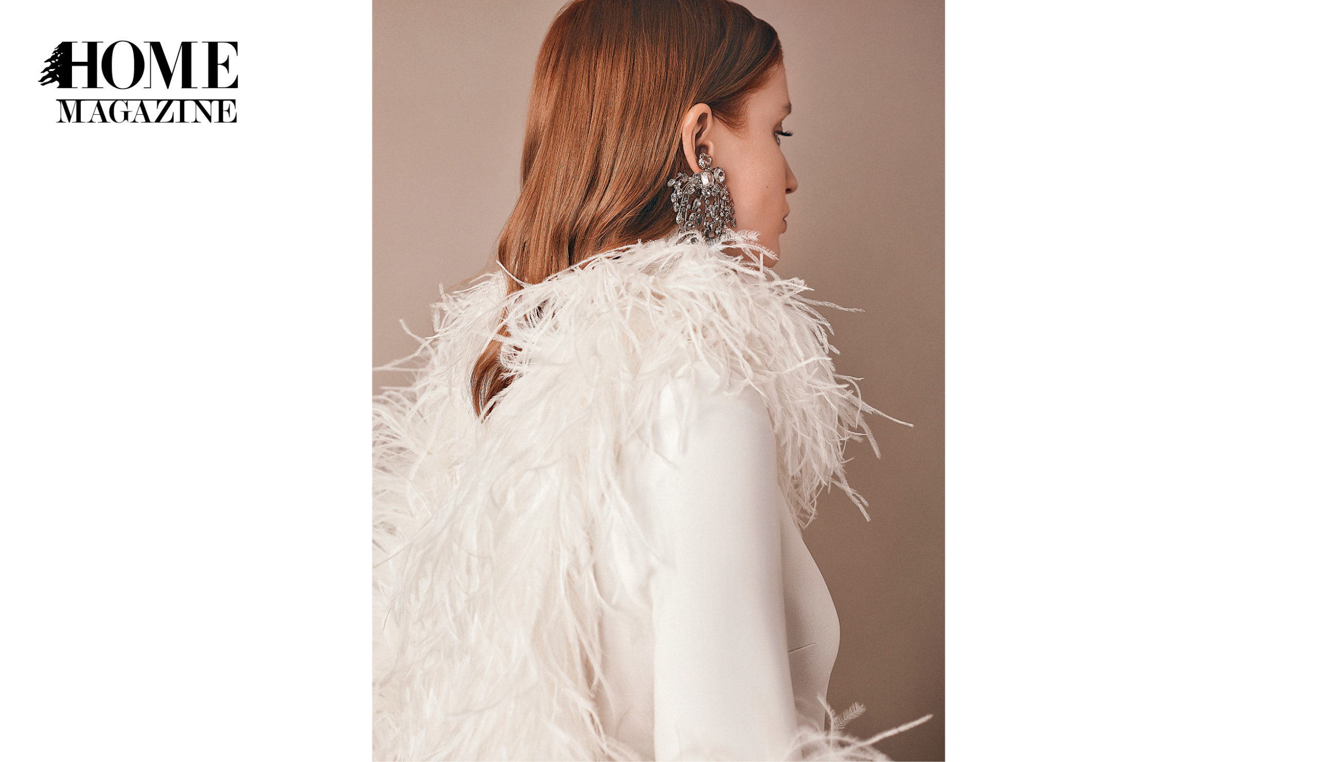 Profile of a model wearing big silver earing and a white blouse with feathers