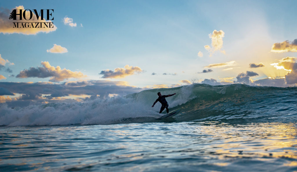 Man surfing a wave and blue sky