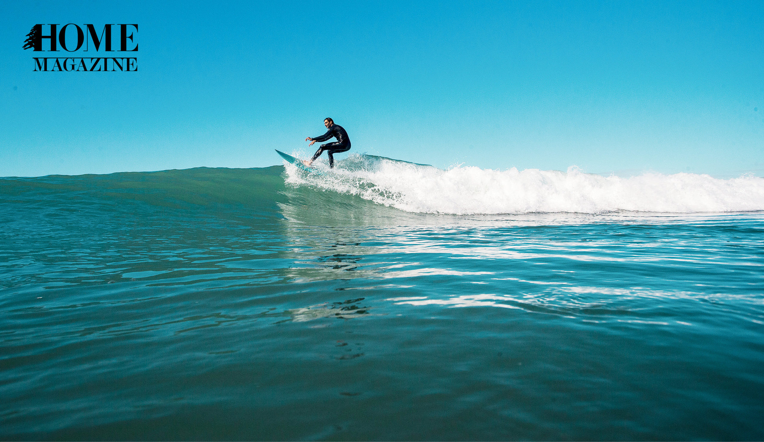 Man riding a board on waves of sea
