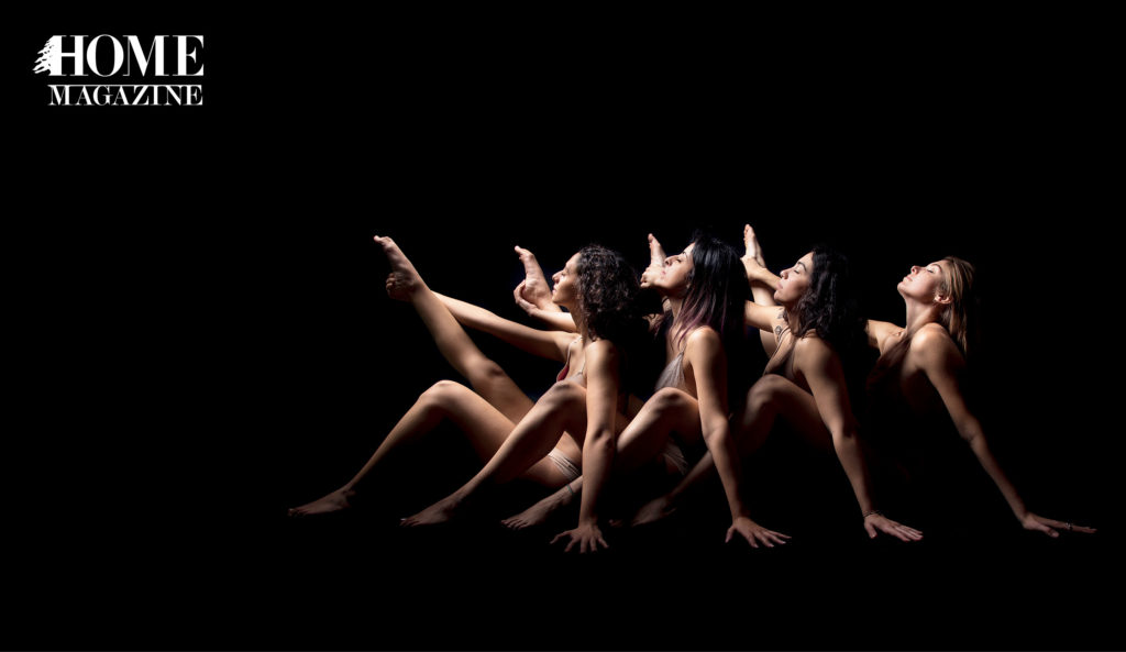 Four women stretching in the dark