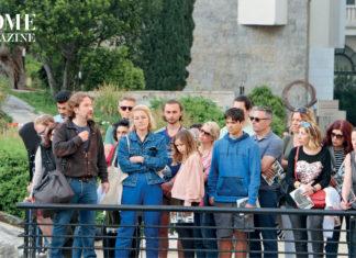 Group of people behind a metal barrier