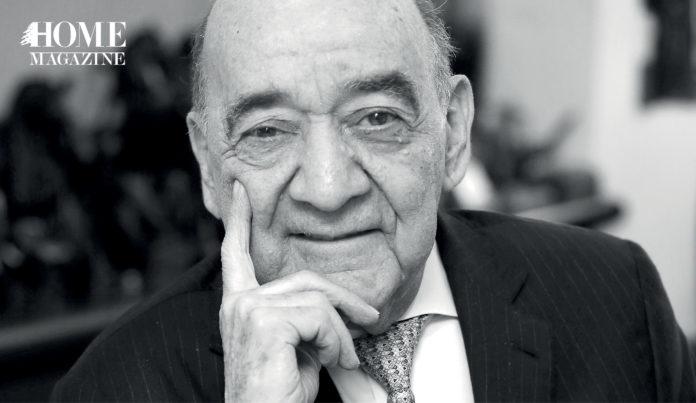 Portrait of a bald man in a suit