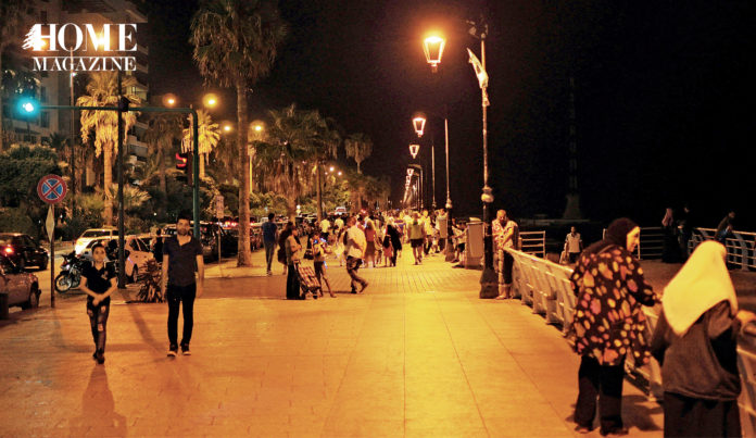 People on a corniche at night