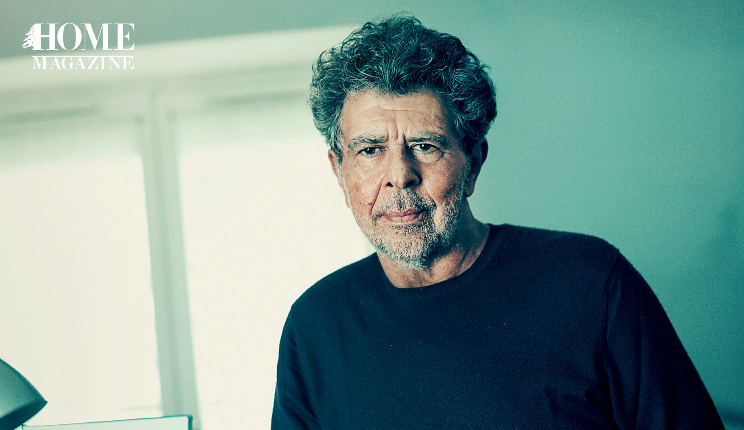 Man with curly hair in black shirt