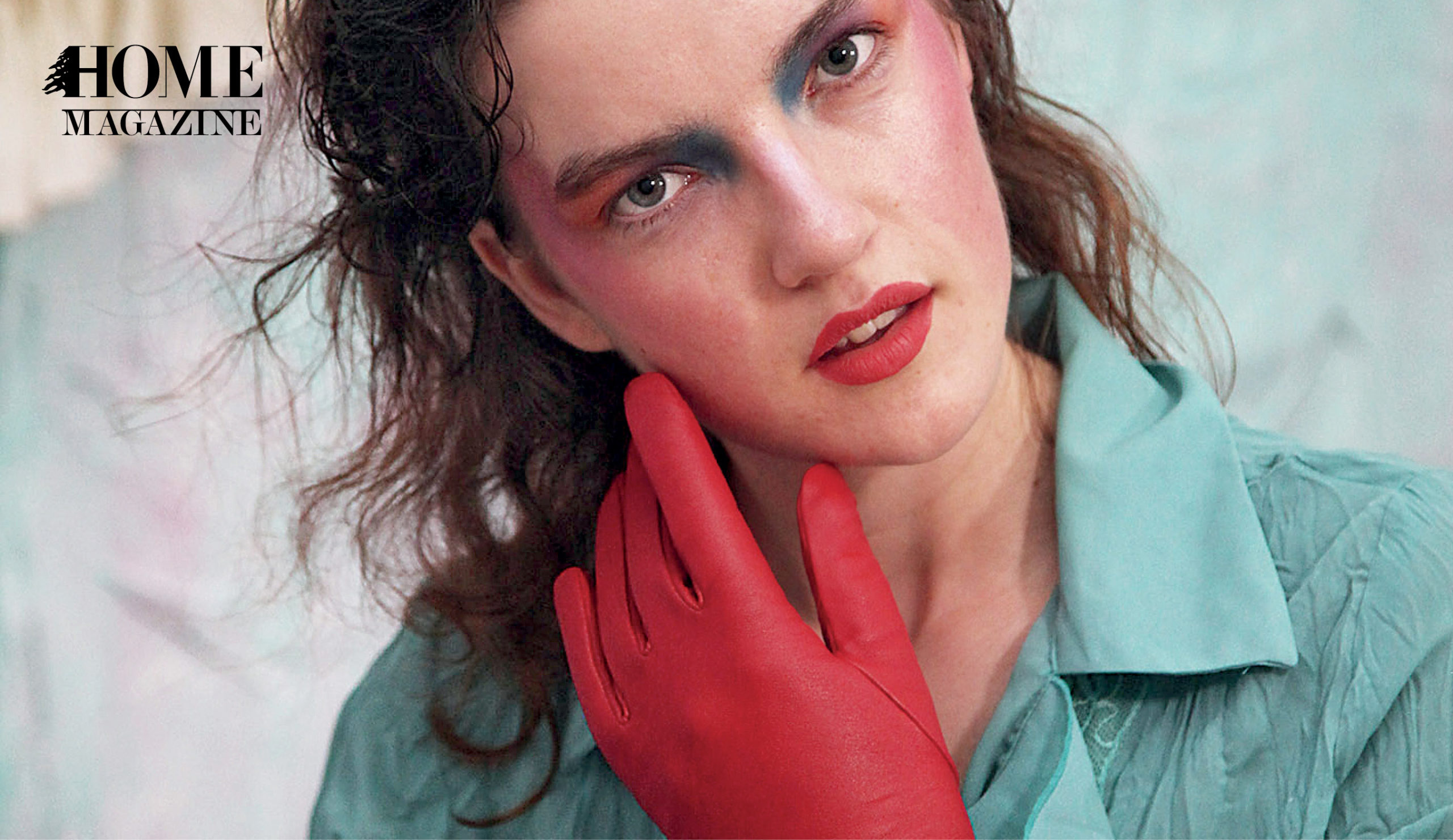Face portrait of a woman with makeup, a red glove and a blue shirt
