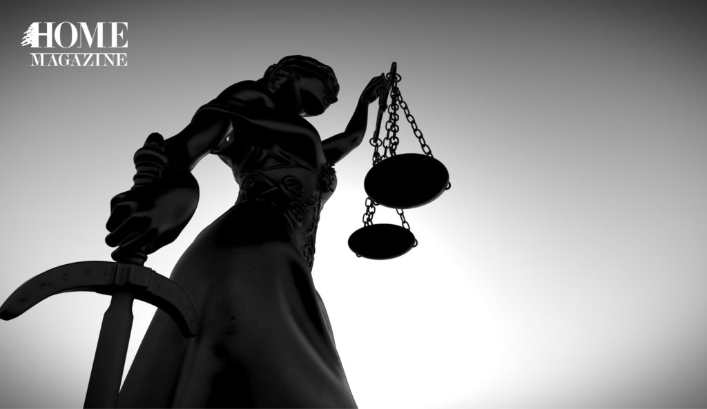 a statue of a women holding the balance of justice